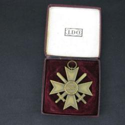 cased war merit badge in bronze
