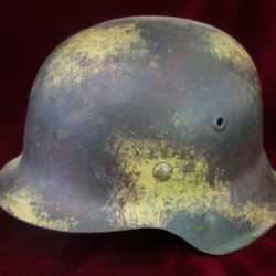 M42 German helmet with camouflage