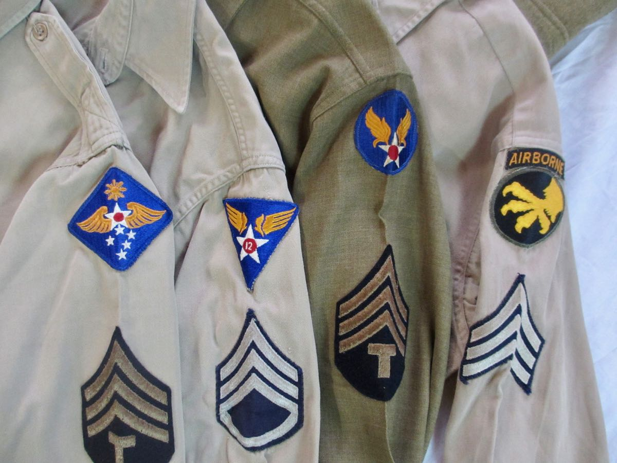 U. S. Service shirts with insignia