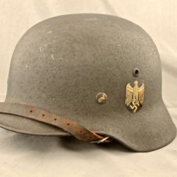 German M35 combat helmet with textured overpaint.