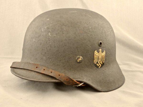 German M35 combat helmet with textured overpaint.